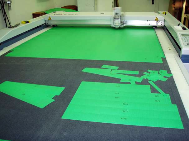 a factory with a dedicated table for cutting materials